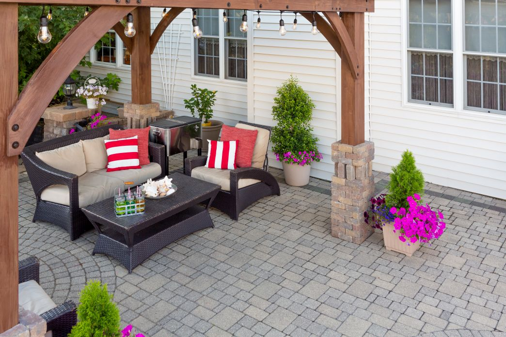 Comfortable chairs on an outdoor brick patio