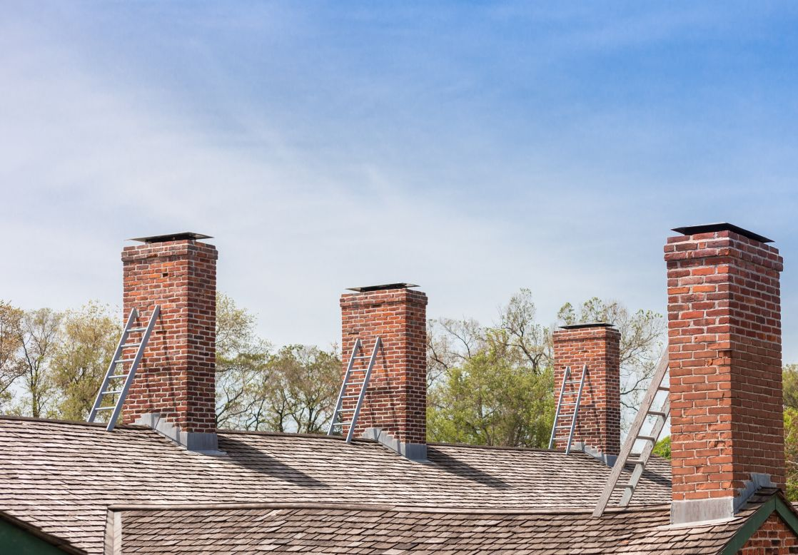 four chimneys with individual ladders on the roof